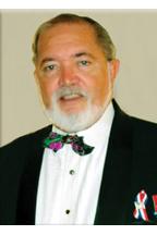 Mancham, Sir James R.